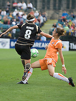 Julianne Sitch (38) slide tackles Tiffany Weimer (8). FC Gold Pride defeated Sky Blue FC 1-0 at Buck Shaw Stadium in Santa Clara, California on May 3, 2009.