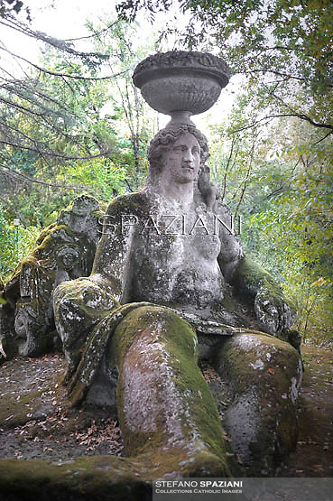 "Ceres,..Ceres the Goddess patron of Rome. The Park of the Monsters of Bomarzo.The Park of the Monsters  also named Sacred Wood is a Renaissance monumental complex located in Bomarzo, in the province of Viterbo, in northern Lazio, Italy.25 jun 2012..In the region of Lazio, the marvellous land of the Etruscans, the Romans and the Middle Ages, lies the village of Bomarzo which shares all the glory of the region's illustrious history and possesses an historical site which is the only one of its kind in the world: ""The Villa Of Marvels"". In the gardens of other villas in Lazio you will find certain similirities, but the prototype of all these gardens remains the ""Sacred Wood of Bomarzo"", that popular fancy rebaptized as Monster's Park. Prince Pier Francesco Orsini, known as Vicino, wanted such a park ""only to ease the heart"". It was designed and laid out by the great architect, Pirro Ligorio, who was summoned to work at Saint Peter's in Vaticano after the death of Michelangelo. Without either Prince Orsini or Ligorio ever realizing it, a timeless masterpiece was born. When you visit this park you will go from surprise to surprise as animals and figures in stone suddenly appear: the Elephant that is about to kill a Warrior, the fighting Dragons, the Ogre in whose mouth you could pic-nic, Sleeping Beauty, Hercules tearing Cacus apart, Bears in ambush, animals with three heads, Neptune presiding figures, and finally a globe of the world balanced on the head of an Orc with a model of the Orsini Castle on top representing the power of his family. These sculptures carred out of massive boulders in situ, appearing to rise up out of the very ground as if by magic. It all goes back to the 16th Century (1552), the period which saw the development of an ideal of life between Prince and Courtier. This wood has inspired many important artists and poets of the time such as Annibal Caro, Bitussi and Cardinal Madruzzo wanted to express their wonder and wished to leave their ""epigraphs a"