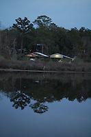 Boat house on Miflin Creek near Foley Alabama, reflecting on the water at dusk. Spring 2008