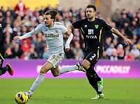 Saturday, 08 December 2012<br /> Pictured: Michu (L) and Russel Martin (R).<br /> Re: Barclays Premier League, Swansea City FC v Norwich City at the Liberty Stadium, south Wales.