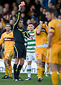 MOTHERWELL'S TIM CLANCY IS SENT OFF AFTER A CLASH WITH CELTIC'S GARY HOOPER.