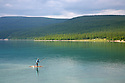 Mongolian man on a raft Lake Khovsgol Mongolia