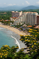 Travelers enjoy the light blue waters off Playa del Palmer in Ixtapa's Commercial Zone, where many of Ixtapa's high-rise hotels are located. (photo taken August 2007) Photo by Patrick Schneider Photo.com