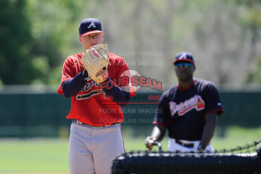 Pitcher Bradley Roney (50) of the Atlanta Braves farm system in a Minor League Spring Training workout on Monday, March 16, 2015, at the ESPN Wide World of Sports Complex in Lake Buena Vista, Florida. The pitching coach behind him is Derrick Lewis. (Tom Priddy/Four Seam Images)