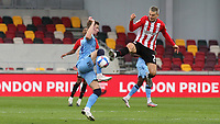 Ben Sheaf of Coventry City and Brentford's Sergi Canos challenge for the ball during Brentford vs Coventry City, Sky Bet EFL Championship Football at the Brentford Community Stadium on 17th October 2020