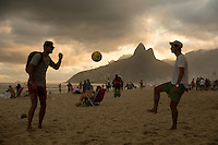 Beach football players on Ipanema in Rio de Janeiro with Sugarloaf Mountain behind