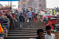 People walk through the street market on Meena Bazar in the Chadni Chowk area of Delhi, India, on Tue., Dec. 11, 2018. In the background, Jama Masjid, one of India's largest mosques, can be seen.