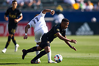 CARSON, CA - MAY 8: Samuel Grandsir #11 of the Los Angeles Galaxy upends Diego Palacios #12 of LAFC during a game between Los Angeles FC and Los Angeles Galaxy at Dignity Health Sports Park on May 8, 2021 in Carson, California.