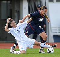 US foreward #20 Abby Wambach is challenged by Iceland #3 Olina Vidarsdottir at the 2010 Algarve Cup game in Vila Real Sto. Antonio, Portugal.