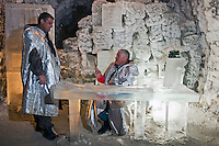Yakutsk, Yakutia, Russia, 19/08/2011..Nikolai Dzhoi and his son Ilya in a businessman's office, complete with portrait of Russian President Dmitri Medvedev, inside the Permafrost Kingdom, an underground tourist attraction inspired by the extreme cold of Yakutia. The 150 metre deep complex of tunnels in the Russian permafrost are decorated with ice sculptures, a wolf-fur covered throne, an office complete with the coolest computer and telephone, a children's slide and other ingenious creations - all hewn from blocks of ice.