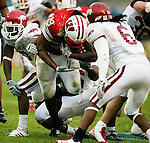Running back P.J. Hill pushes through the Razorback line in the third period of the Capital One Bowl.<br />