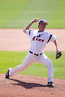 Sam Johns (19) of the Evansville Purple Aces delivers a pitch during a game against the Indiana State Sycamores in the 2012 Missouri Valley Conference Championship Tournament at Hammons Field on May 23, 2012 in Springfield, Missouri. (David Welker/Four Seam Images)