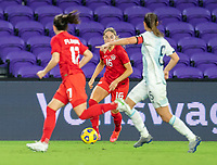 ORLANDO, FL - FEBRUARY 21: Janine Beckie #16 of Canada dribbles during a game between Canada and Argentina at Exploria Stadium on February 21, 2021 in Orlando, Florida.