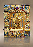 Medieval gilded manuscript cover depicting the Crucifixion. 11th century from the treasury of the Cathedral of Maastricht. AD.  <br />