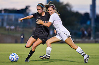 Texas defender Isabelle Kerr (14) is pushed by Texas State forward Lauren Prater (6) for the ball during first half of an NCAA soccer game, Sunday, September 21, 2014 in San Marcos, Tex. Texas defeated Texas State 2-0. (Mo Khursheed/TFV Media via AP Images)