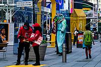 NEW YORK, NY - OCTOBER 20: Independent workers wait for tourists at Times Square on October 20, 2020 in New York, with more than a 72% decline in tourism activity since the spread of the pandemic. Hotels, restaurants, museums, are more affected across New York State.  (Photo by Eduardo MunozAlvarez/VIEWpress)