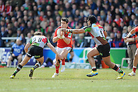 Conor Murray of Munster Rugby is tackled by Nick Evans (left) and Maurie Fa'asavalu of Harlequins during the Heineken Cup quarter final match between Harlequins and Munster at the Twickenham Stoop on Sunday 7th April 2013 (Photo by Rob Munro)