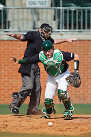 Charlotte 49ers catcher Patric King (28) chases down a dropped third strike as home plate umpire Barry Chambers gives the safe sign during the game against the Canisius Golden Griffins at Hayes Stadium on February 23, 2014 in Charlotte, North Carolina.  The Golden Griffins defeated the 49ers 10-1.  (Brian Westerholt/Four Seam Images)