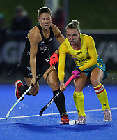 Jane Claxton is tackled by Rose Keddell of NZ during the Sentinel Homes Trans Tasman Series hockey match between the New Zealand Black Sticks Women and the Australia Hockeyroos at Massey University Hockey Turf in Palmerston North, New Zealand on Thursday, 27 May 2021 Photo: Simon Watts / bwmedia.co.nz