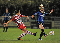 20131001 - VARSENARE , BELGIUM :  duel pictured between Brugge's Jana Coryn (right) and Antwerp Nathalie Weytjens (left) during the female soccer match between Club Brugge Vrouwen and Royal Antwerp FC Ladies , of the fifth matchday in the BENELEAGUE competition. Tuesday 1 October 2013. PHOTO DAVID CATRY
