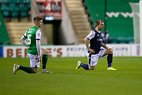 15th November 2020; Easter Road, Edinburgh, Scotland; Scottish League Cup Football, Hibernian versus Dundee FC; Kevin Nisbet of Hibernian and Paul McGowan of Dundee take a knee before kick off