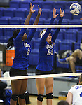 Marymount's Morgan McAlpin and Emileigh Rettig block during a college volleyball match at Washington & Lee University Lexington, Vir., on Saturday, Oct. 5, 2013.<br /> Photo by Cathleen Allison