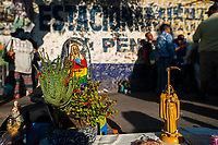 Statues of Santa Muerte (Holy Death) are seen placed on the street during a religious pilgrimage in Tepito, Mexico City, Mexico, 1 April 2018. The religious cult of Santa Muerte is a fusion of Aztec death worship rituals and Catholic beliefs. Born in lower-class neighborhoods of Mexico City, it has always been closely associated with crime. In the past decades, original Santa Muerte followers, such as prostitutes, pickpockets and street drug traffickers, have merged with thousands of ordinary Mexican Catholics. The Holy Death veneration, offering a spiritual way out of hardship in modern society, rapidly expanded. Although the Catholic Church still considers Santa Muerte followers the devil worshippers, on the first day of every month, crowds of Santa Muerte believers fill the streets of Tepito. Holding statues of Holy Death clothed in a long robe, they pray for healing, protection, money or any other favor in life.