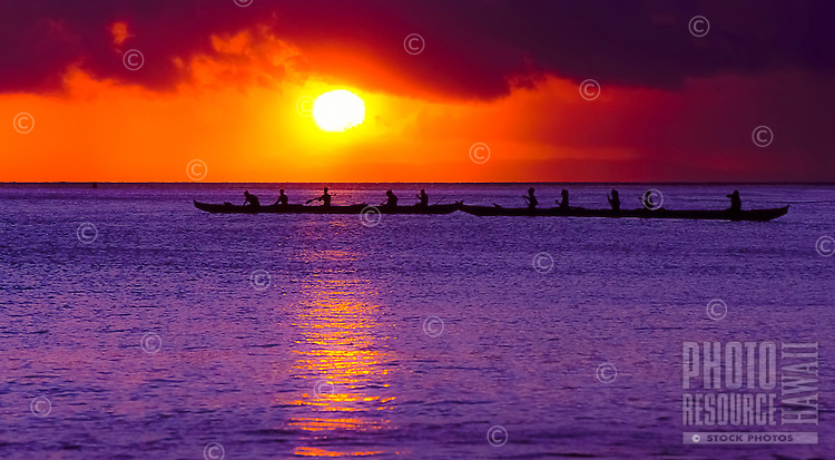 Men and women outriggers (outrigger canoe paddlers) at sunset off of Ka'anapali Beach, Maui.