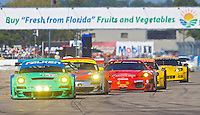 A pack of GT cars race down the frontstretch early in the 12 Hours of Sebring, Sebring, FL, MArch 20, 2010.  (Photo by Brian Cleary/www.bcpix.com)