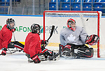 Sochi, RUSSIA - Mar 2 2014 -  Brad Bowden gets a shot past Corbin Watson during practice before the 2014 Paralympics in Sochi, Russia.  (Photo: Matthew Murnaghan/Canadian Paralympic Committee)