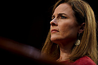 Amy Coney Barrett, U.S. President Donald Trump's nominee for associate justice of the U.S. Supreme Court, listens during a Senate Judiciary Committee confirmation hearing in Washington, D.C., U.S., on Tuesday, Oct. 13, 2020. Democrats get their first crack at questioning Barrett today during her hearing, where they plan to focus on how she might move the court in a more conservative direction on issues such as health care and abortion.<br /> CAP/MPI/RS<br /> ©RS/MPI/Capital Pictures