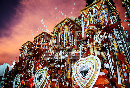 Rio de Janeiro, Brazil. Carnival; Portela samba school float with red and white costumes. Sapucai sambadrome at dawn.