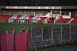 Witton Albion 1 Warrington Town 2, 26/12/2017. Wincham Park, Northern Premier League. A visiting player begins his warm-up routine on the pitch at Wincham Park, home of Witton Albion before their Northern Premier League premier division fixture with Warrington Town. Formed in 1887, the home team have played at their current ground since 1989 having relocated from the Central Ground in Northwich. With both team chasing play-off spots, the visitors emerged with a 2-1 victory, the winner being scored by Tony Gray in second half injury time, watched by a crowd of 503. Photo by Colin McPherson.