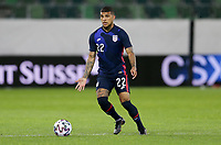ST. GALLEN, SWITZERLAND - MAY 30: DeAndre Yedlin #22 of the United States looks for an open man downfield during a game between Switzerland and USMNT at Kybunpark on May 30, 2021 in St. Gallen, Switzerland.