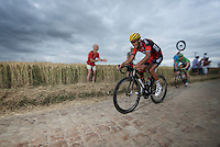 Greg Van Avermaet (BEL/BMC) on the cobbled sector of Artres (1200m) followed closely by green jersey André Greipel (DEU/Lotto-Soudal)<br /> <br /> stage 4: Seraing (BEL) - Cambrai (FR) <br /> 2015 Tour de France