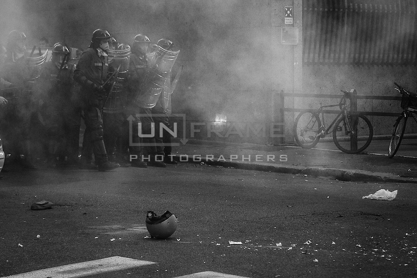 A Police deployment in riot gear hunts for protesters after the Ministry of Economy has been  attacked with crude homemade explosive devices and acts of vandalism. Rome, Italy. 19 October 2013