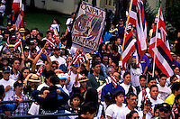 "Throngs of people carrying Hawaiian flags march to commemorate the 100th anniversary of the U.S. overthrow of the Hawaiian monarchy. Observance known as """"Onipa'a"""". (to hold firm)"