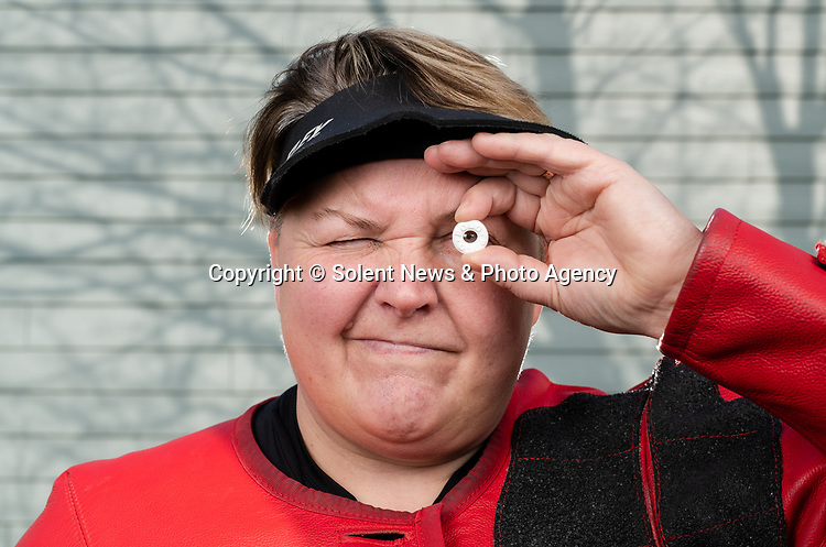 MINT SHARPSHOOTER<br /> <br /> Pictured: ParalympicsGB shooter Lorraine Lambert has been practicing at home after being called up to compete at the Tokyo 2020 Paralympic Games by shooting through the hole of a Polo mint, which measures 80mm wide, from 10 metres with her rifle during lockdown at her home in Portsmouth, Hants. <br /> <br /> © Jordan Pettitt/Solent News & Photo Agency<br /> UK +44 (0) 2380 458800