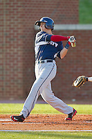 Ryan Cordell (9) of the Liberty Flames follows through on his swing against the High Point Panthers at Willard Stadium on March 23, 2013 in High Point, North Carolina.  The Panthers defeated the Flames 9-3.  (Brian Westerholt/Four Seam Images)