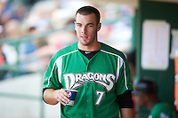 Dayton Dragons infielder Sean Buckley #7 in the dugout during a Midwest League game against the Fort Wayne TinCaps at Parkview Field on August 19, 2012 in Fort Wayne, Indiana.  Dayton defeated Fort Wayne 5-1.  (Mike Janes/Four Seam Images)