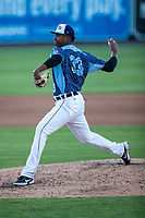 West Michigan Whitecaps pitcher Xavier Javier (33) delivers a pitch to the plate against the Great Lakes Loons at LMCU Ballpark on May 11, 2021 in Comstock Park, Michigan. (Andrew Woolley/Four Seam Images)