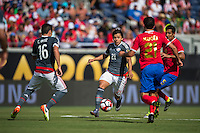 Orlando, Florida - Saturday, June 04, 2016: Paraguayan forward Oscar Romero (21) is confronted by Costa Rican forward Marco Urena (21) during a Group A Copa America Centenario match between Costa Rica and Paraguay at Camping World Stadium.