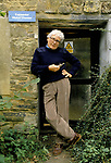 James Lovelock, British independent scientist, author, & environmentalist, outside his exponential dilution chamber converted from a barn, holding an electron capture detector.