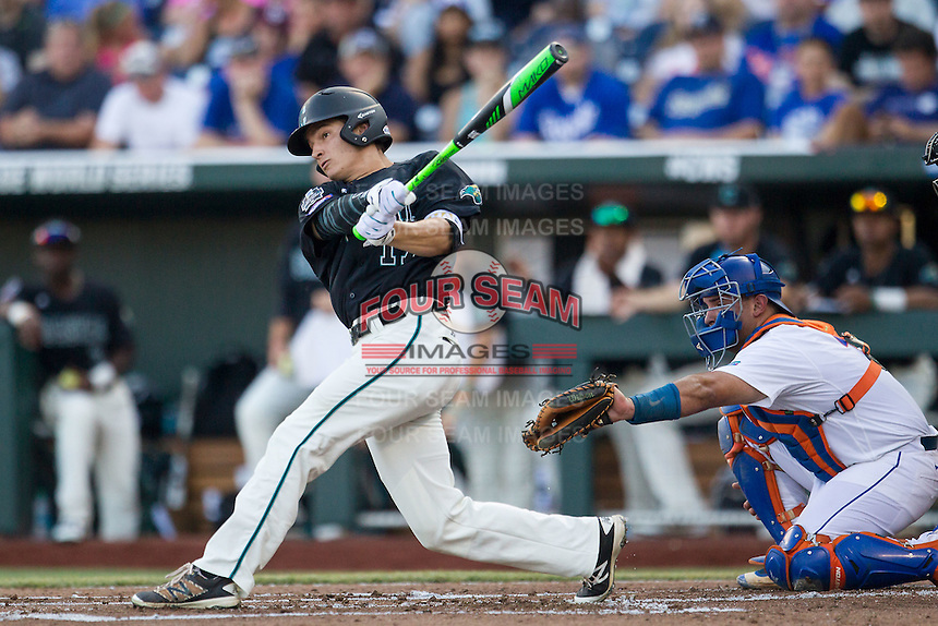 Coastal Carolina Chanticleers outfielder Billy Cooke (17) follows through on his swing against the Florida Gators in Game 4 of the NCAA College World Series on June 19, 2016 at TD Ameritrade Park in Omaha, Nebraska. Coastal Carolina defeated Florida 2-1. (Andrew Woolley/Four Seam Images)