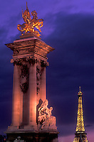 Paris, Eiffel Tower, France, Europe, A monument at The Pont Alexandre in the [evening, night] with the Eiffel Tower in the background in Paris.