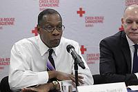 Conference de presse de la croix rouge. le 8 j anvier 2015.<br /> Dickens St-Vil, <br /> Conrad Sauvé (D)<br /> <br /> PHOTO : Agence Quebec Presse