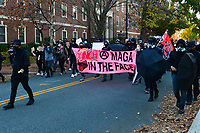 """Washington, DC - November 14, 2020: Anti-Trump protesters march thru the streets of the District of Columbia after the """"Stop The Steal"""" rally in support of President Trump near the U.S. Supreme Court.  November 14, 2020.  (Photo by Don Baxter/Media Images International)"""