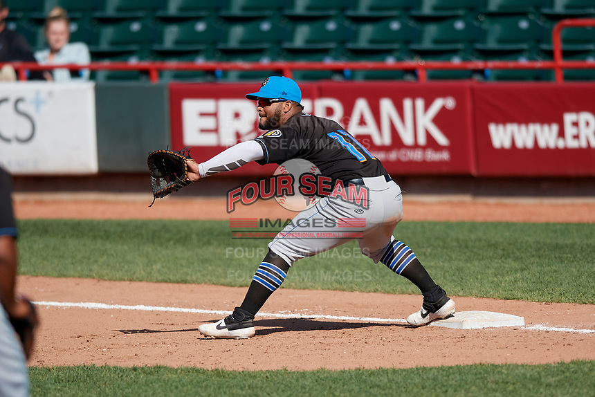 Akron RubberDucks first baseman Wilson Garcia (11) stretches for a throw during an Eastern League game against the Erie SeaWolves on June 2, 2019 at UPMC Park in Erie, Pennsylvania.  Erie defeated Akron 8-5 in eleven innings of the second game of a doubleheader.  (Mike Janes/Four Seam Images)