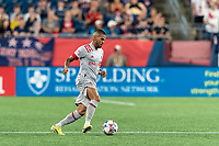 FOXBOROUGH, MA - JULY 7: Auro Jr #96 of Toronto FC passes the ball during a game between Toronto FC and New England Revolution at Gillette Stadium on July 7, 2021 in Foxborough, Massachusetts.