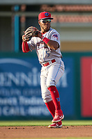 Clearwater Threshers shortstop Luis García (5) throws to first base during a game against the Fort Myers Mighty Mussels on May 12, 2021 at Hammond Stadium in Fort Myers, Florida.  (Mike Janes/Four Seam Images)
